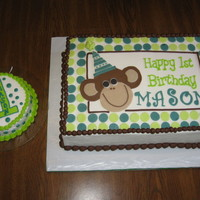 Our Little Monkey  1st Birthday Cake for a friend's son. Iced with buttercream. Monkey, name, and polka dots are MMF. The sides are imprinted with the...