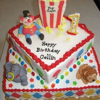 Circus Cake - First Birthday  Circus themed cake for a 1 year old. Buttercream with MMF fondant accents. Popcorn made from mini-marshmallows. Peanut border made with...