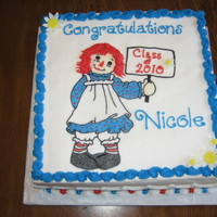 Nicole's Graduation This a 10 x 10 cake with a frozen buttercream transfer (with a couple of MMF flowers). The ragdoll is my neice's class mascot.