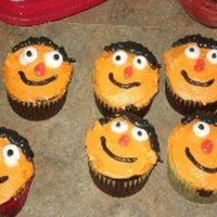 Ernie Cupcakes Iced in buttercream with marshmallow eyes.