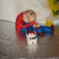 Fondant_Rhys.jpg This figure was on the cake board for my brother in law'a 40th birthday cake. He is a painter by trade, loves his beer and has very...