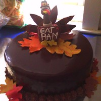 Turkey Cake I made this for my daycare class for our Thanksgiving feast. The kids and parents loved it. The turkey and leaves are made out of modeling...
