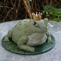 Billy The Bull Frog A hand carved cake in 3 d of a bull frog. Billy is adorned with a gold Sugar crown.