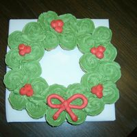 Mini Cupcake Wreath First cupcake cake. Made with about 26 mini cupcakes. I wanted to make some of these for Christmas, and since I had never done anything...