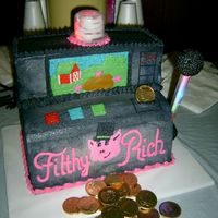 Slot Machine The picture doesn't really do this cake justice. The top blinks, and the handle also blinks. It was super fun to make....I was proud...