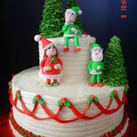 Christmas Elves Cake  Here is a picture of the finished cake I made the elves for. Red Velvet Cake with Cream Cheese Filling and Icing. Gumpaste/Fondant Elves,...