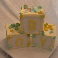 Baby Boy Blocks Shower Cake  This cake was for a friend of a friend. I'm so happy with how it turned out. Everything is edible including the baby, the baby booties...