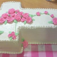 Cross Cake - 1St Communion - Girl   Three layer white cake with butter cream frosting.