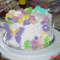 May24_Class_Cake_027.jpg My sister and I both took this class together and had a blast. This is my class 2 final cake. I am very pleased with it.