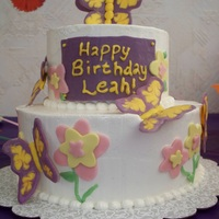 Butterfly Birthday Mr Banana Legs cake from Cake Love book, IMBC, candy melt butterflies & plaque, and fondant flowers