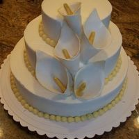 "50Th Anniversary W/ Calla Lillies White cake w/ rasp filling and vanilla crusting buttercream. Gum pastecalla lillies. Thanks for the inspiration and permission to ""..."