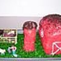 Barnyard I made this cake for my son's 4th Birthday that was Barnyard themed. The barn is 2 loaf cakes stacked on top of each other. The Silo...