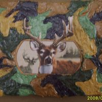 Camo & Buck  This was a cake I made for my Boyfriend's 7yr old son who LOVES hunting. The image is just an edible transfer and the camo is just BC...