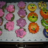 Flowers And Monsters! My first try at cupcakes! The little girl wanted pink flowers for the girls in her class and then sports for the boys. I thought a football...