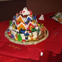Christmas Village I made all of the decorations for this cake and my co-worker made the cake and covered it in fondant. We entered it in a cake decorating...