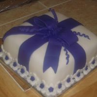Package / Gift Cake White cake w/vanilla buttercream and fondant accents.