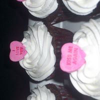 Cupcakes Chocolate cupcakes with vanilla frosting and a candy heart.For some reason i cant get the picture to upload correctly. sorry