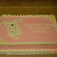 Baby Shower Cake For A Girl This baby shower cake was made for a girl. The onesie is all fondant.