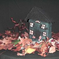 Booootiful Abode  So this is my very first house cake so why not make it a haunted house right? This is a chocolate suicide cake of course. Covered in...
