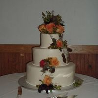 Geneva Wedding This cake was chocolate cake with alternating layers of chocolate ganache and raspberry. It was covered in ivory fondant with a simple...
