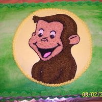 Curious George Curious george cake, iced all in buttercream. I made the circle by tracing a plate and my son in law drew the George for me to transfer...