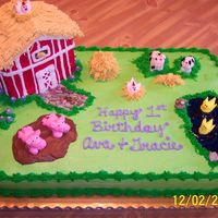 Barnyard Birthday Cake I decorated this for a friend's twin girls. The barn is made out of cake and all the animals are made from buttercream and fondant....