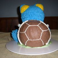 Back Of 3D Blastoise Pokemon Turtle Cake This is the Back side of my 3D Blastoise Pokemon Turtle cake - Had to secure the shell some with wooden dowels - was afraid it would fall...