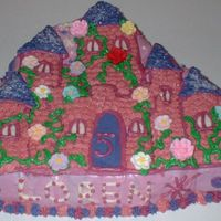 The Castle This is a chocolate fudge cake constructed with special castle-formed pan. The cake is frosted with cream cheese frosting. It is decorated...