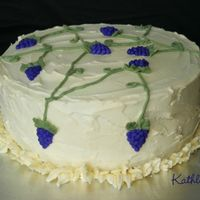 "Grapes On The Vine 8"" Lemon cake with lemon curd/BC center. Idea from the Wilton Course 1 book. I always liked the look of the cake. It looks okay but I..."