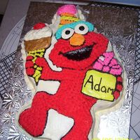 Elmo This was my first charecter cake! I never thought there would be so much work to one of these, but it turned out pretty good!