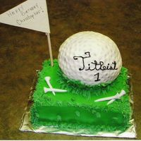 Buttercream Golf Ball This is a cake I did for a friends son. The ball and grass are all buttercream with fondent tees. Not the easiest cake I ever made.