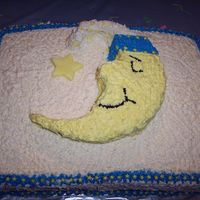 100_1646.jpg I made this for my sister-n-law's baby shower. I used a sheet cake and a 10 in round for the moon. I used fondant for the star....