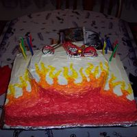 American Chopper For my son's 8th birthday he wanted a American Chopper theme. His cake had to have flames and a chopper. I used a sheet cake pan and a...