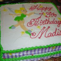 Tinkerbell The side of the cake is purple ribbon. I drew Tinkerbell on top, and was happy with most of it except for her face. It obviously doesn&#039...