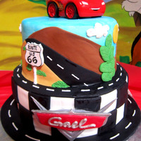 Cars Cake Everything edible except for the toy car on top!