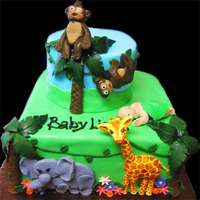 Jungle Themed Baby Shower Cake  I made a zebra and lion (not pictured, on the sides of the cake) elephant, giraffe and monkeys. The little baby in the leaf was a fun...