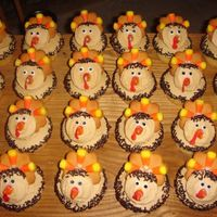 Turkey Cupcakes!! These are from a fantastic cupcake book I have. Really fun to make, and HILARIOUS to look at! It's funny seeing an army of turkeys...