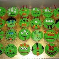 Green Monster Cupcakes!! These are some monster cupcakes I made (last minute of course!) for my son's Kindergarten class. I made them all green to save time,...