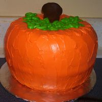 Pumpkin Cake I made this for a fall festival at my church. Two bundt spice cakes inverted on each other.