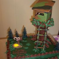 Deer Stand  This is a cake I made for my dh's B-Day. The tree trunk is made from 7 plastic dowel rods taped together and the deer stand is...