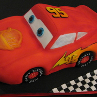 Lightning Mcqueen The famous car. Made in yummy chocolate cake for a lucky 4-year-old.