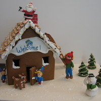 Rudolph And Friends With Habitat For Humanity  This was made for a Habitat for Humanity auction. I made a scene of Rudolph the Red-nosed Reindeer and his friends building a Habitat house...