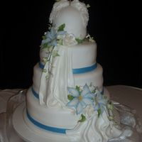 4 Tier Fondant Wedding Cake With Draping 4tier fondant wedding cake with fondant ribbon, and draping. Also fondant doves and gumpast flowers