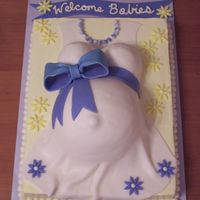 Pregnant Belly   This was requested for a baby shower for two expecting mommies. chocolate cake. swiss meringue buttercream. fondant dress and accents.