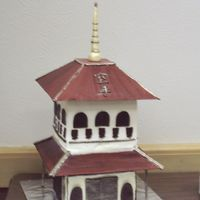 "Pagoda Cake  I made this for my Husband's Black Belt Cermony. The roof is Gumpaste, ""glued"" together with almond bark. The top Cake is a..."