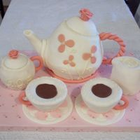 "Tea Party Cake Teapot, teacups, and Sugar and cream bowls are cakes coverd in MMF. Hanles and Rose tops are bubblegum. used tootsie rolls for ""tea&..."