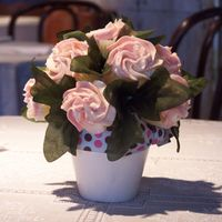 Cupcake Bouquet  I made these for our local mothers league membership lunch. They were used as the centerpiece for each table. mini-lemon cupcakes. swiss...