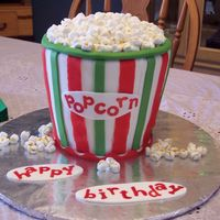 Christmas Carnival Popcorn Cake! for a two-year old's birthday. the theme was a christmas carnival. used SMbuttercream, MMF, Fruit by the Foot (red stripes) and...