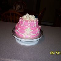 Pink And White For My Sister's B-Day spice cake with english toffee filling and cream cheese icing. first time doing swags and using cake sparkles. they sure add to the cake.