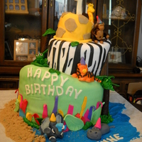 It's A Jungle Out There Three tiered Jungle animal cake.